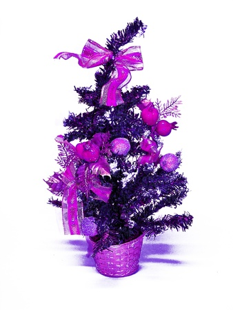 Purple x-mas tree isolated on white photo
