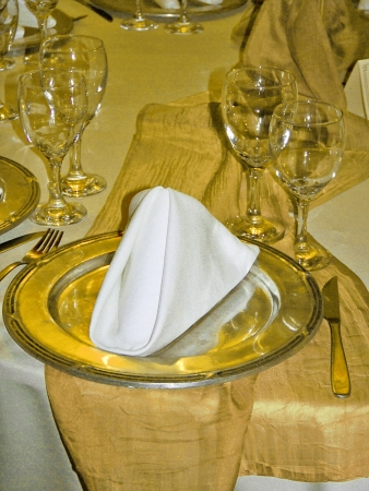 Gold elegant wedding table service plate close-up photo