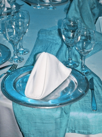 Cyan light blue illumination on elegant birthday party table plate close-up photo