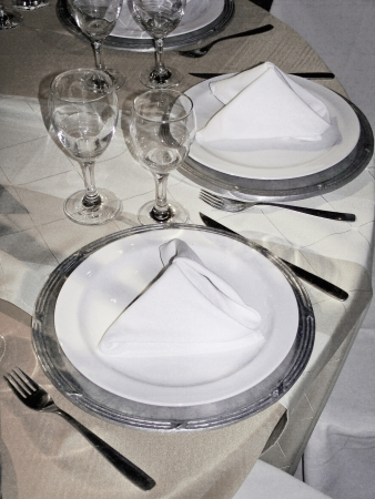 Silver and white party table service close-up photo