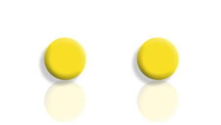 mirrored: Two yellow balls mirrored and isolated on white with copyspace