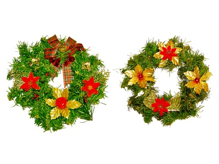 Couple of gold red and green x-mas ornamental crowns photo