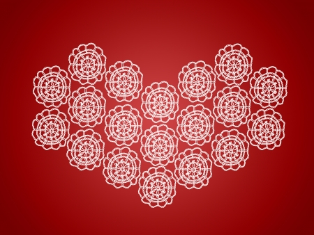 Heart Christmas background of white crochet isolated on red photo