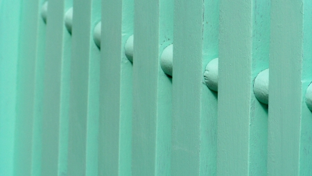 verticals: Aqua green wood painting fence close up background Stock Photo