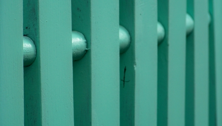 verticals: Emerald green wood fence abstract background of vertical striped Stock Photo