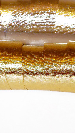 metalized: Golden brilliant christmas ribbon texture background isolated on white  Stock Photo