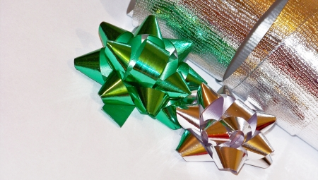 Couple of christmas stars of silver and green ribbons isolated on white photo