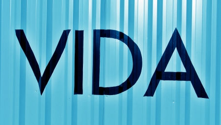 typographies: Vida spanish word meaning life on blue metallic striped background