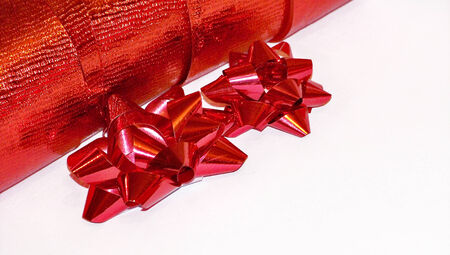 metalized: Christmas flowers of red ribbon isolated on white background Stock Photo