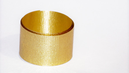 metalized: Gold christmas ribbon roll isolated on white horizontal background with copyspace