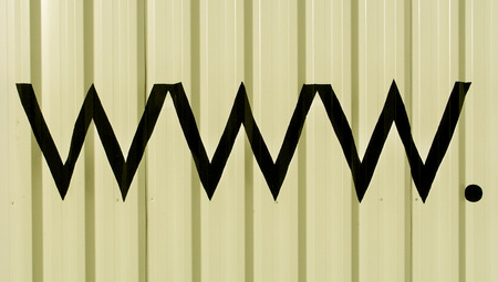typographies: www  black letters on white striped wall background Stock Photo