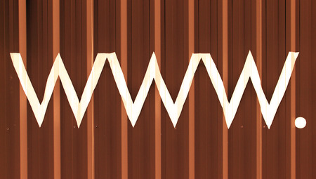 typographies: Internet domains letters www and the dot in white on chocolate striped background