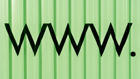 typographies: Internet domains letters www and the dot in black on light green striped background Stock Photo