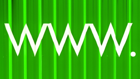 typographies: www initials of World Wide Web green striped background