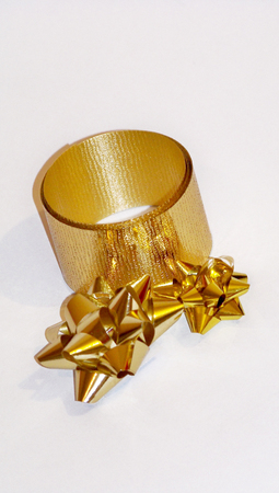 christmas stars: Golden christmas stars and ribbon isolated on white