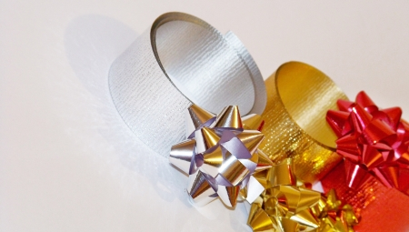 metalized: Gold silver and red xmas stars and ribbons and thread for gifts packages on white Stock Photo