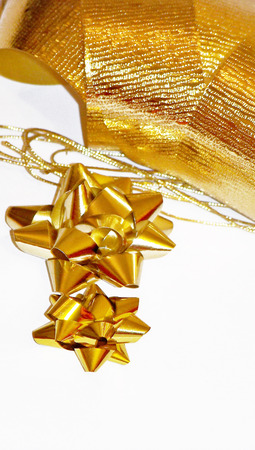 metalized: Gold christmas star flowers and ribbons isolated on white Stock Photo