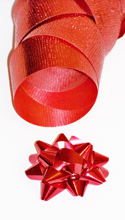 metalized: Red christmas flower and ribbon close up isolated on white Stock Photo