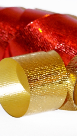 metalized: Gold and red christmas ribbons close up isolated on white