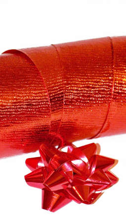 Red christmas ribbon and star close up isolated on white photo