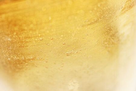 Yellow bubbles glass background close up photo