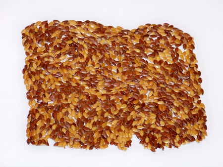 Flax seeds cracker raw cookie isolated on white photo