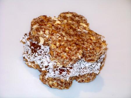 alfajor: Flower alfajor dessert of seeds and coconut on white