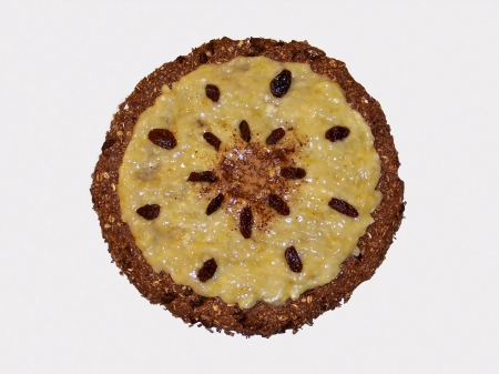 Bananas and chocolate tart cake with grapes mandala design isolated on white photo