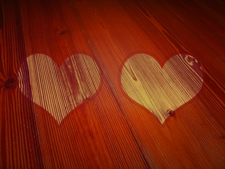 romaticism: Couple of wood hearts valentines background