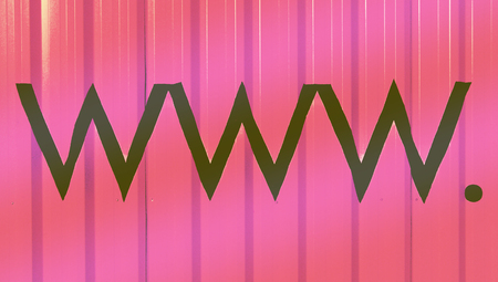 www  website letters on pink abstract striped background photo