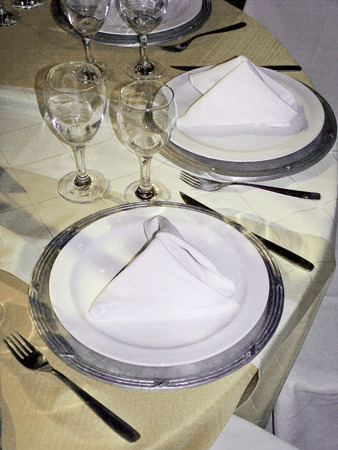 Elegant wedding table close up in white and silver photo