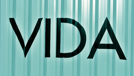 typographies: Vida word meaning life in english on blue striped background Stock Photo