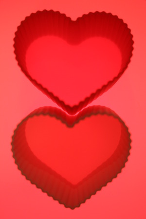 Red hearts couple on brilliant abstract background photo