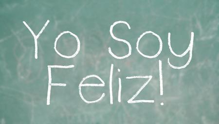 Yo soy feliz, I am happy, school positive message of the day on blackboard photo