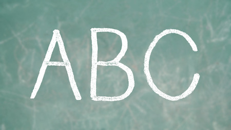 ABC letters of chalk on green blackboard background photo