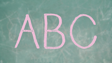 Pink ABC letters on school blackboard background photo