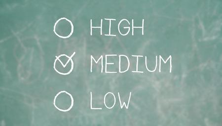 medium close up: Medium option on school blackboard of chalk