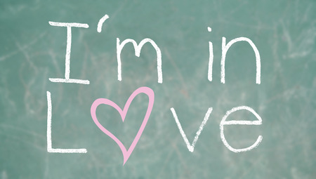 i am: I am in love conceptual image on class blackboard background Stock Photo
