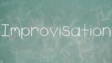 improvisation: Improvisation chalk word on a blackboard of school
