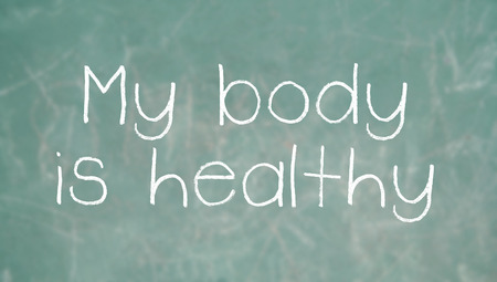 affirmations: Positive affirmation my body is healthy on chalk on class blackboard