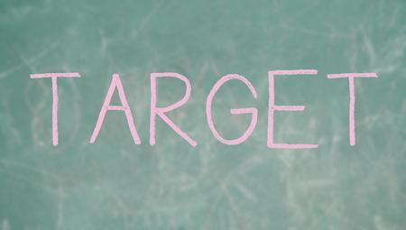 Target pink chalk word on school blackboard photo