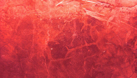 Bloody red painting cracked grunge wall texture abstract background photo