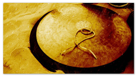Golden Tibetan cymbal on sand Stock Photo - 27388168