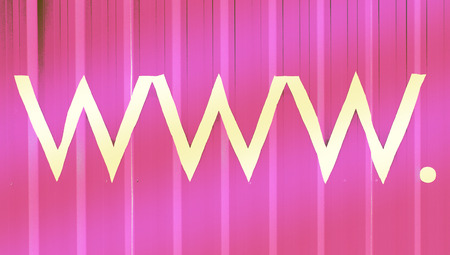 typographies: Www domain letters symbols on pink abstract background Stock Photo