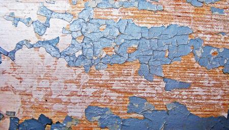 Turquoise paint cracked surface on old wood background photo