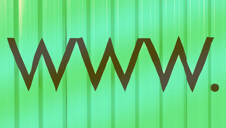 Www domain letters signs on green stripes background photo