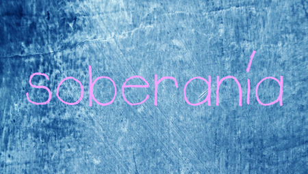 sovereignty: Sovereignty word in spanish class blue grunge background Stock Photo