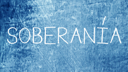 sovereignty: Soberan�a or sovereignty chalk word on blue spanish class blackboard background Stock Photo