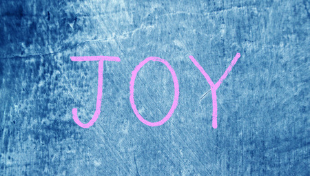 chalky: Pink joy letters on blueboard chalky background Stock Photo