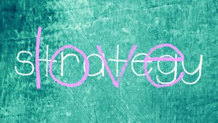 love strategy: Love strategy written words on blue chalkboard